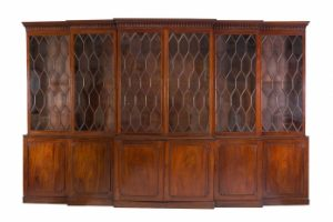 A LARGE GEORIGAN MAHOGANY DOUBLE BREAKFRONT BOOKCASE (10,000-15,000)