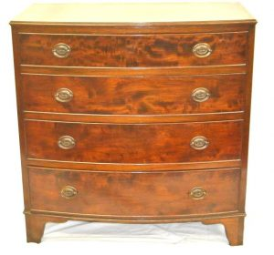 A bow front chest of drawers by Cork furniture makers O'Connells