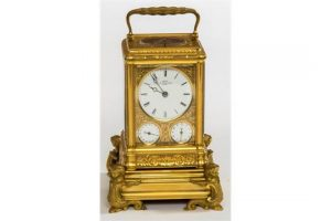 A French brass sonnerie repeater clock by Grohe.